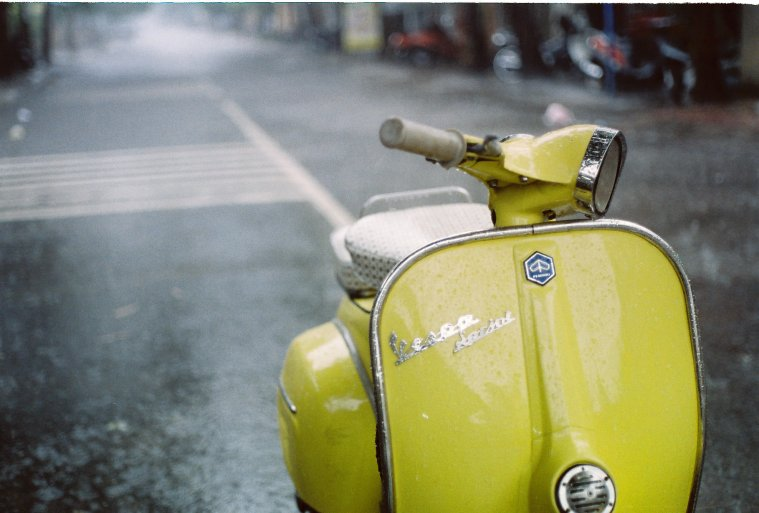 Yellow Vespa in the Rain by Khánh Hmoong